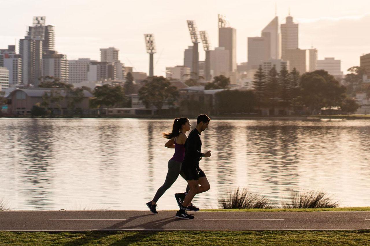 two runners enjoy a morning run along the Swan river